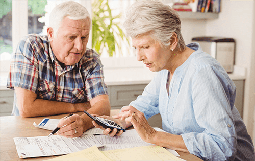 elder couple looking over documents
