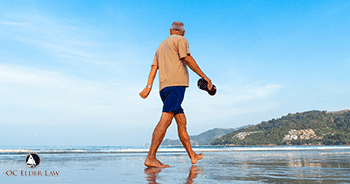 Older man walking on the beach