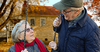 Elderly couple on a swing
